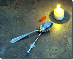Heroin syringe and spoon